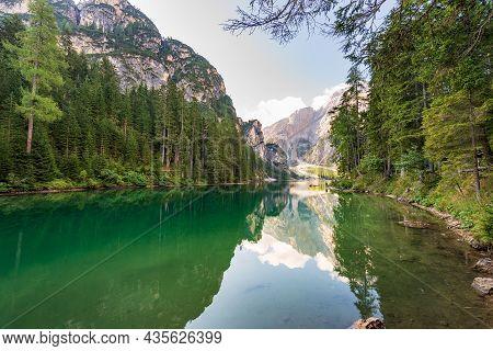 Small Beautiful Lake In Italian Alps. Pragser Wildsee Or Lago Di Braies And Mountain Range Of Croda