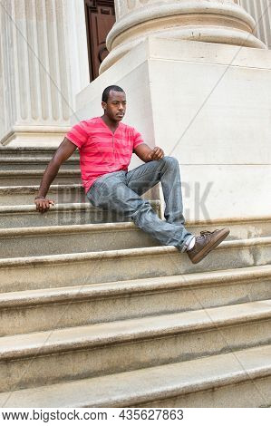 Dressing In Red, Pink Lines T Shirt,  Gray Pants, Leather Brown Shoes And A Bracelet, A Young Black