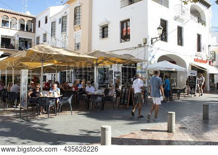 Nerja -  Spain - September 22 2021 :  Tourists On The Costa Del Sol Relax In Bars And Restaurants In