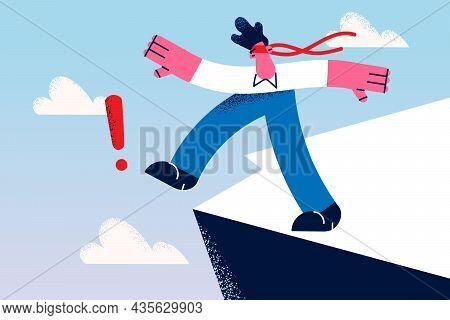 Business Risks And Challenge Concept. Young Businessman Wearing Red Ribbon On Eyes Walking To Abyss