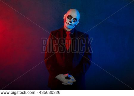 Handsome Man With Scary Skull Halloween Make Up Dead Day Calavera Style On Blue Smoke Background