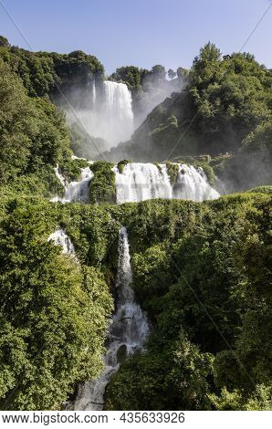 Marmore Waterfall In Umbria Region, Italy. Amazing Cascade Splashing Into Nature With Trees And Rock