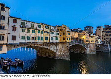 Florence, Italy - Circa June 2021: Sunset On Ponte Vecchio - Old Bridge. Amazing Blue Light Before T