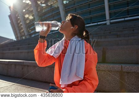 Thirsty Sporty Millennial Woman Hold Bottle Drink Water After Workout Training Outdoors. Active Tone