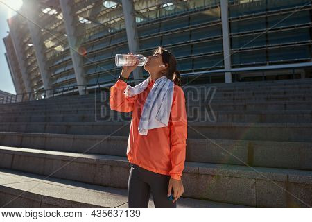 Thirsty Millennial Toned Girl After Workout Training Drink Water From Bottle. Active Sporty Woman In