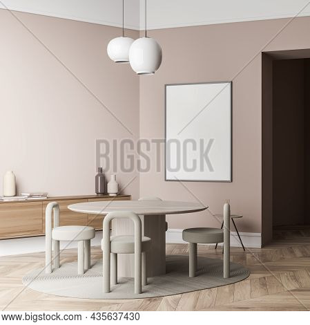 Canvas On Wall Of Light Beige Living Space Interior With Round Table, Creative Chairs, Two Pendant L