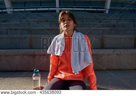Portrait Of Active Sportswoman In Sportswear Relax After Workout Training Outdoors. Sporty Toned Mil