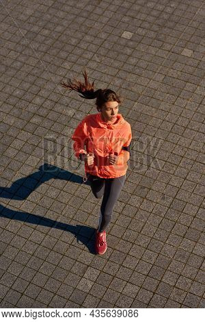 Top Down Of Motivated Sporty Fit Millennial Girl In Sportswear Run Jog On Street In Morning. Active