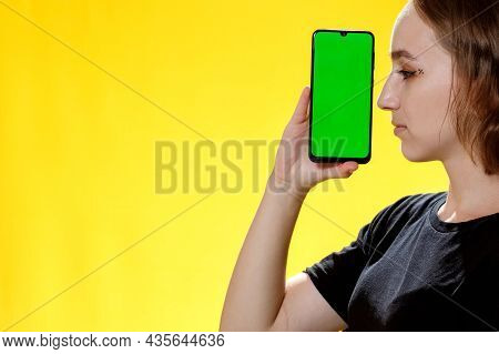 Happy Female Showing Smartphone With Green Screen, Social Network App