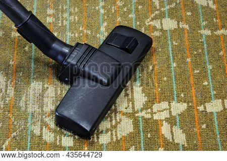 Carpet Cleaning With A Vacuum Cleaner, Sanitary Restoration Of Cleanliness From Garbage. Maintaining