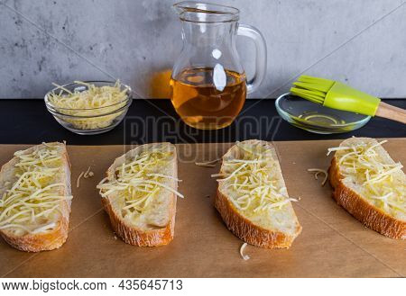 Crispy Ciabatta Slices Coated With Olive Oil And Sprinkled With Grated Cheese, Ready To Be Roasted I