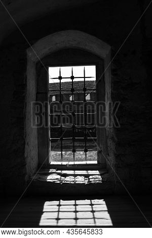 An Old Window In A Gothic Castle With An Iron Grate Casting A Shadow On The Floor. Horror Mystic Hal