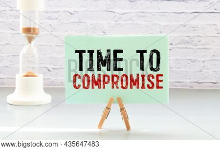 Businesman Hold Notepad With Text Time To Compromise. White Background.