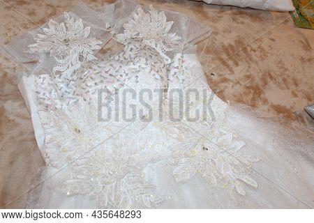 Wedding Gown Lay on a Bed with full accessories behind beautiful gown on pillow Bed wedding event sh