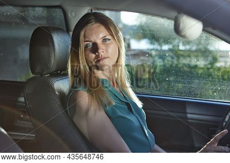 Woman 32 Years Old Is Driving Car At Daytime.