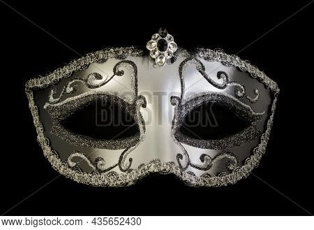 Silver Dominance Masquerade Mask Isolated Against Black Background