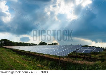 Photovoltaic Modules Solar Power Plant With Puffy Fluffy White Clouds Blue Sky Daylight Background,