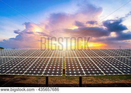 Photovoltaic Modules Solar Power Plant On Dramatic Sunset Sky Background,clean Alternative Power Ene