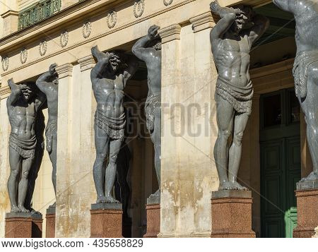 Saint Petersburg, Russia - July 17, 2021: Sculptures Of Atlanteans Holding The Portico Of The New He