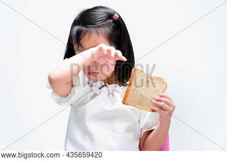 A Cute Little Girl Rubs Her Eyes From The Back Of Her Wrists Due To Itching Or Irritation. Child Hol