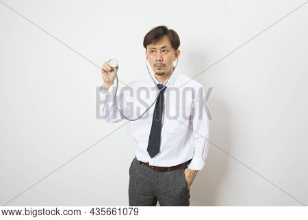 Asian Man Doctor Diagnose With Facemask And Stethoscope Stand On White Background.