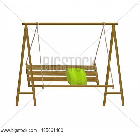 Garden swing bench. Classic outdoor garden wooden hanging furniture with green pillow. Wooden porch swing hanging on frame with ropes. Patio element for relax