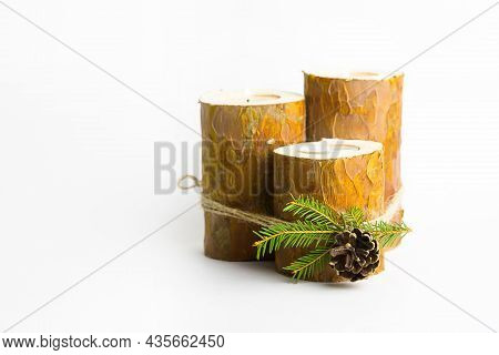 Diy Christmas Candle Holder Made Of Pine Logs, Candles, Craft Rope, Fir Branches And Cones. Finished