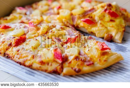 Close Up Of Delicious Seafood Hawaiian Italian Pizza In Delivery Box. Delivery Pizza Packaging Conce