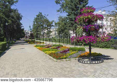 Irkutsk, Russia - August , 2021: Multi-tiered Flower Bed With Blooming Petunias On The Boulevard  On