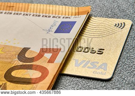 Ukraine - 06.11.2021: Gold Colored Bank Card And Cash, Illustrative Editorial, Illustrative Editoria