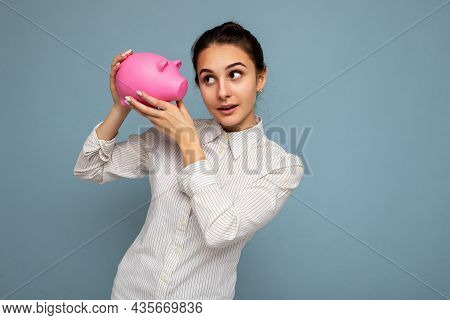 Self-confident Thoughtful Young Beautiful Attractive Woman With Brunette Hair In A Bun With Sincere