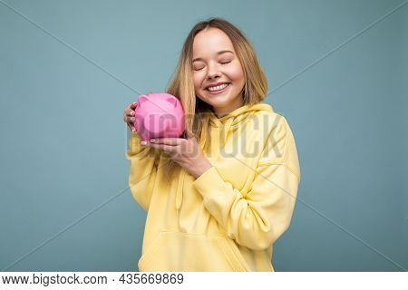 Photo Of Happy Positive Smiling Young Beautiful Attractive Blonde Woman With Sincere Emotions Wearin