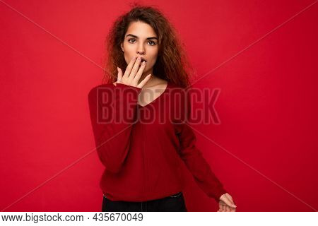 Photo Of Youngshocked Amazed Attractive Brunette Curly Woman With Sincere Emotions Wearing Casual Re