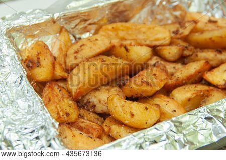 Baked Potatoes In Foil. Food Delivery. Texture Of Baked Potatoes With Skin