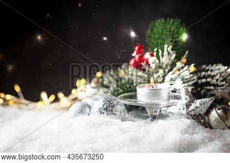 Christmas Decoration With Candles, Fir Branch And Balls On Snow