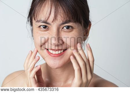 Close Up Face, Young Asian Female Smiling With Water Drop On Her Face. Asian Woman Washing Face Clea