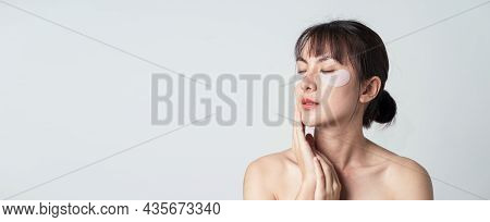 Asian Female Model Posing On Banner And Copy Space. Beautiful Woman Model Wear Collagen Patches Unde