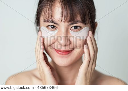 Selective Focus, Patches Collagen Under Eyes On Fresh Clean Skin Of Asian Woman. Closeup Face Of You