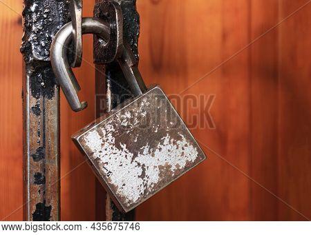 Open Padlock Hanging On A Metal Lattice. Open Access Concept, Login Options, Freedom, Liberation Cop
