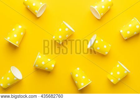 Disposable Paper Cups On The Yellow Background. Top View Of Yellow Cups On The Table. Minimalist Pho