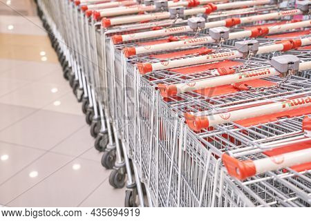 Barnaul, Russia - August 07 2021. Red Shop Carts. Mall Retail Marketplace. Hypermarket Shopper. Groc