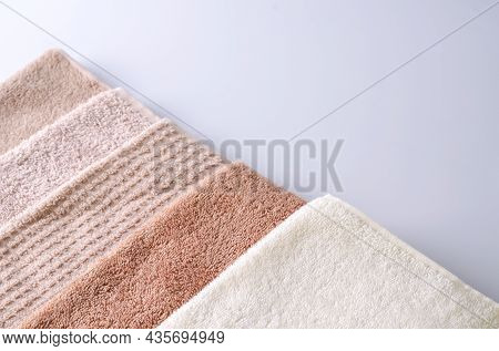Miscellaneous Cotton Soft Towels On A Light Background, Background For Demonstration Of Cosmetic Pro
