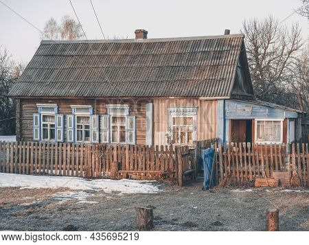 A Lonely Old House In The Village With Blue Shutters On The Windows In Early Spring. The Awakening O