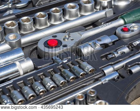 A Close-up Of A Set Of Tools For Repairing A Car And Other Things. Wrenches, Bits, Attachments. Side