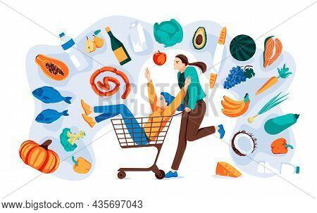 Two Girls Ride In Supermarket Trolley With Many Goods, Drinks, Fresh Fruits And Vegetables Around Th