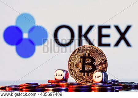 Kazan, Russia - Oct 7, 2021: Okex Is A Cryptocurrency Exchange. Golden Bitcoin With Two Buy-sell Cub