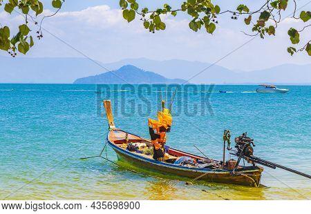 Long-tail Boat At Pier On Island Koh Phayam Thailand.
