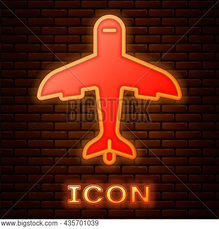 Glowing Neon Plane Icon Isolated On Brick Wall Background. Flying Airplane Icon. Airliner Sign. Vect