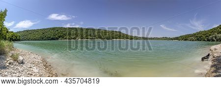 Beautiful Lake At Baresia Sur L'ain With River Aim In The Jura Region In France With Dog At Riverban