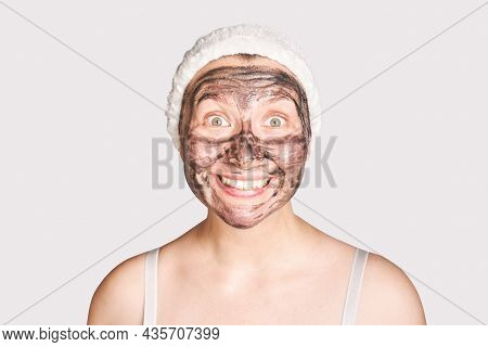 Young Woman Applying Black Face Mask. Wow Emotion. Charcoal Facial Product. Acne And Pimple Removing